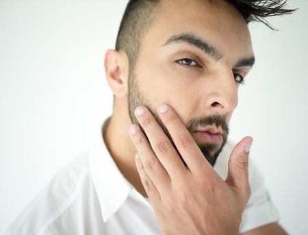 male hair: Portrait of attractive man taking care of his skin and beard