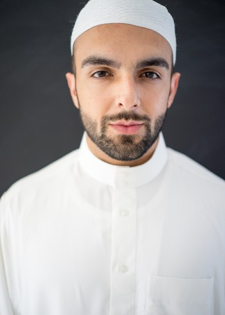 qameez: Arabic young businessman posing with hat