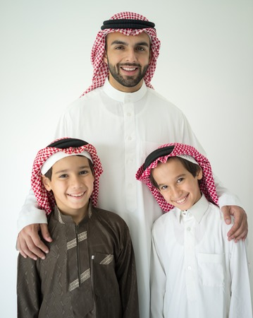 arab model: Arabic young father posing with kids