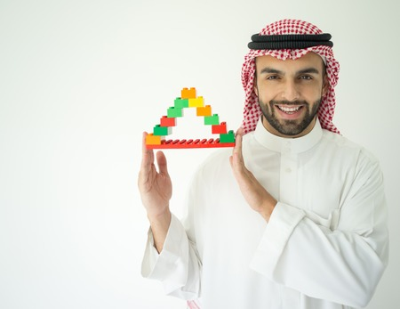 arabic man: Arabic young businessman building cube house