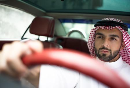 arabic man: Arabic young businessman driving car Stock Photo