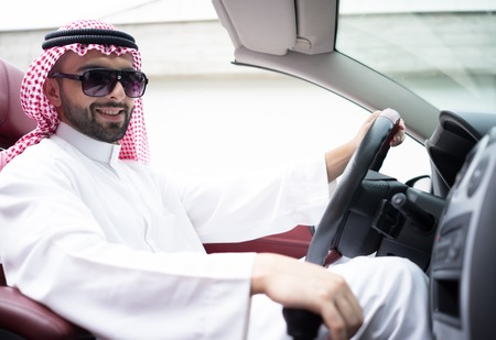 Arabic young businessman driving car Standard-Bild