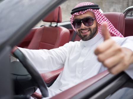 arab model: Arabic young businessman driving car Stock Photo