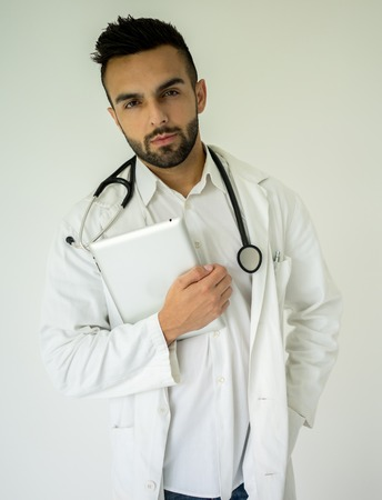 Attractive modern doctor with tablet photo