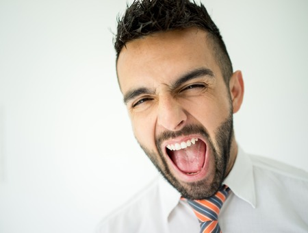 loudly: Portrait of attractive man loudly yelling