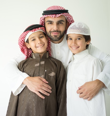 arab man: Arabic young father posing with kids