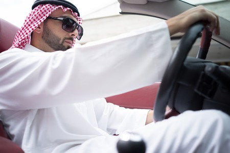 arab man: Arabic young businessman driving car Stock Photo