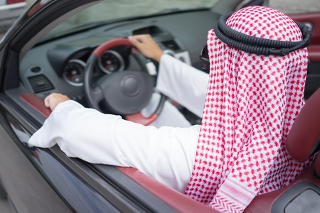 keffiyeh: Arabic young businessman driving car Stock Photo
