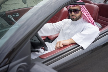 Arabic young businessman driving car Stock Photo