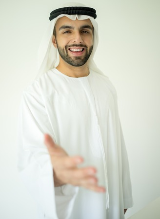 new contract: Young Arabic business man hand shaking for new contract Stock Photo