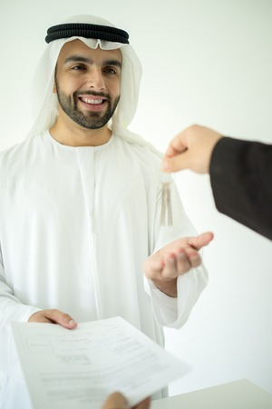 deal making: Arabic man making successful deal Stock Photo