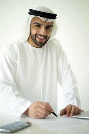 arabic man: Arabic man making successful deal Stock Photo