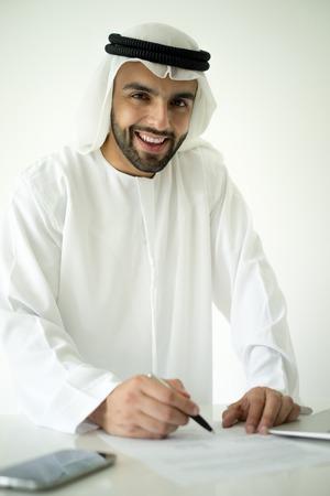 deal making: Arabic man making successful deal Stock Photo