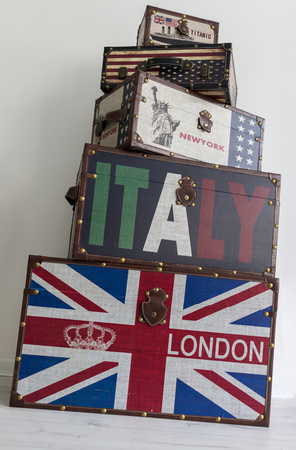 voyage: Old style voyage suitcase with travel stickers and flags Stock Photo