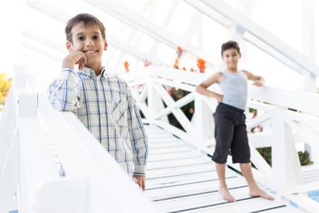 vivid: Happy kids spending holiday vacation in beautiful resort