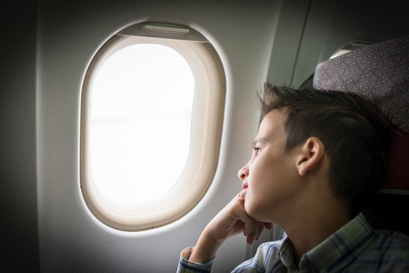 10 years old: Kid traveling by airplane