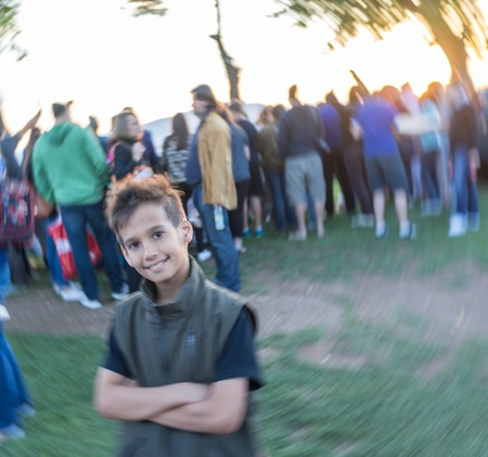 postproduction: Kid standing in crowd of people (Note: Motion blur is real and not made in postproduction)