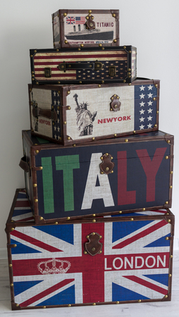 gb: Old style voyage suitcase with travel stickers and flags Stock Photo