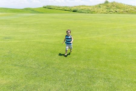 kid running: Little kid running on green meadow