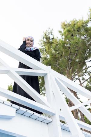 hijab: Beautiful Muslim girl with hijab spending holiday vacation in beautiful resort