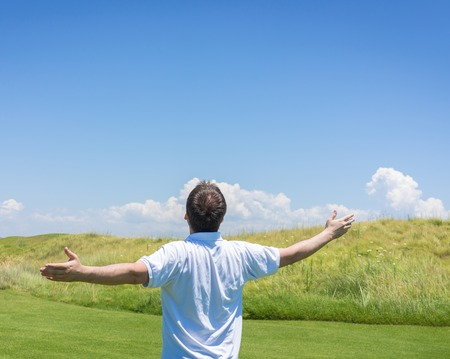 background person: Happy summer vacation for man on green meadow near sea