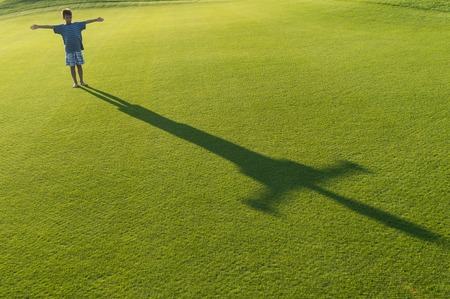sports field: Kids with their shadows on grass