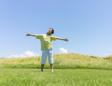 open hands: Boy with open hands in beautiful nature Stock Photo