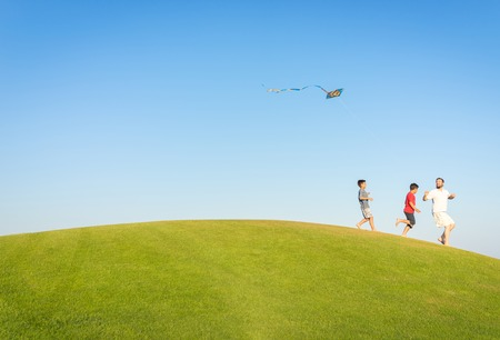 kite: Running with kite on summer holiday vacation, perfect meadow and sky on seaside
