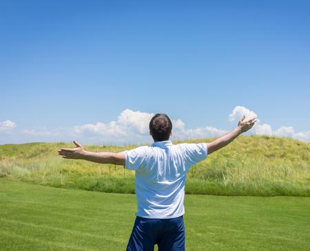 teen golf: Happy summer vacation for man on green meadow near sea