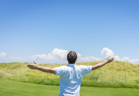 teen golf: Happy summer vacation for man on green meadow near sea