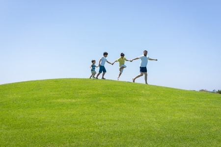 teen golf: Happy summer vacation for family on green meadow near sea