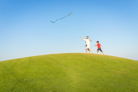 beach toys: Running with kite on summer holiday vacation, perfect meadow and sky on seaside