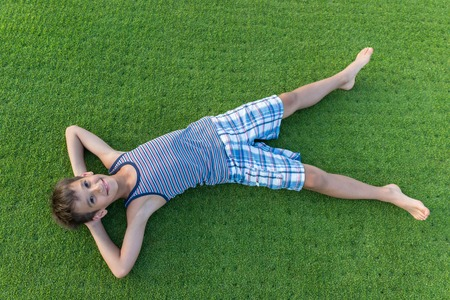 kids outside: Happy summer vacation for kids on perfect meadow grass