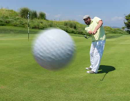 playing golf: Man playing golf at club