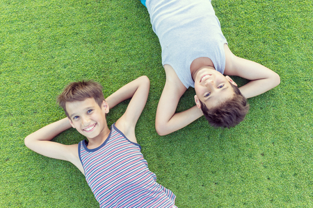 ground: Happy summer vacation for kids on perfect meadow grass