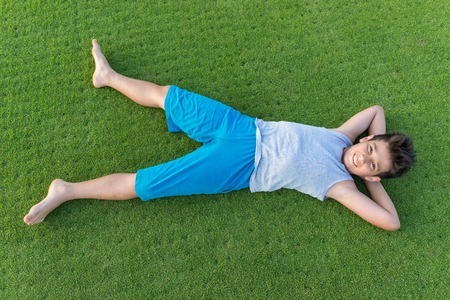 teen golf: Happy summer vacation for kids on perfect meadow grass