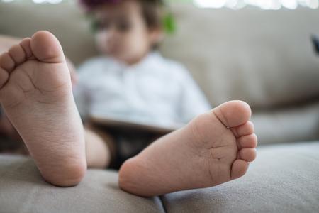 boy kid: Little cute boy feet Stock Photo