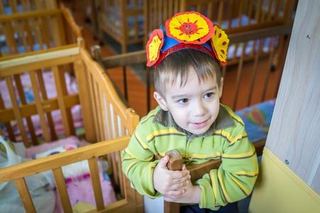 Little kid in kindergarten bedroom