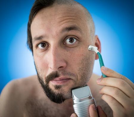 shaving: Man shaving