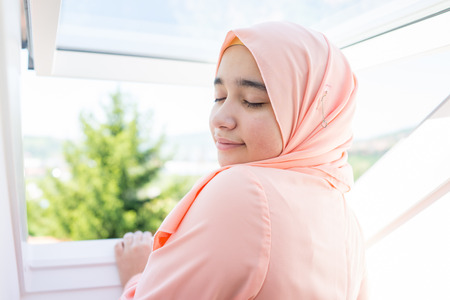 woman window: Beautiful Muslim Arabian girl