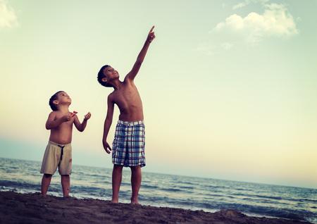 heaving: Little boys on the beach heaving fun