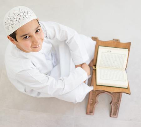 koran: Happy kids reading Koran