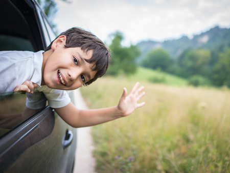 holidays vacancy: Happy kids travel by the car Stock Photo