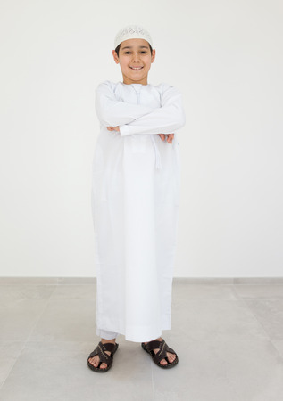 Excited cute Arabic little boy smiling Stock Photo