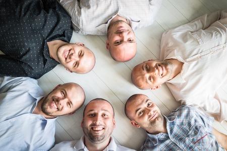 group of men: Young men closeup group portrait