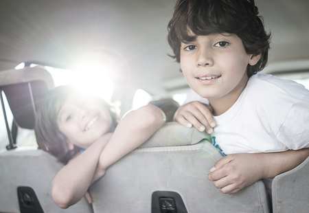 Happy kids travel by the car Stock Photo