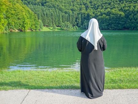 Muslim woman in nature photo