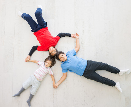 multi age: Kids on the floor together in new home top view Stock Photo