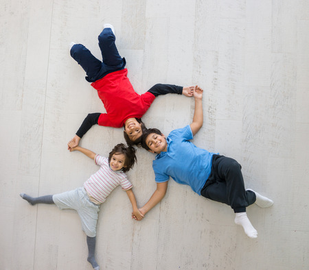 Kids on the floor together in new home top view Stock Photo