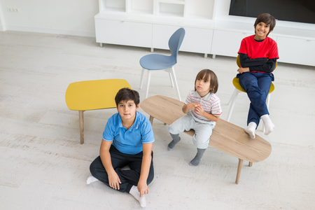 gesturing: Happy group of kids at new modern beautiful home